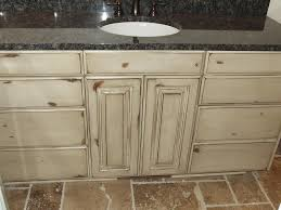 how to refinish alder wood cabinets antique white knotty alder cabinets antique white kitchen