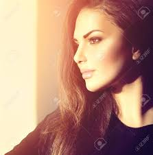 hair i woman s chin sideways sideways portrait of young beauty romantic girl looking away stock