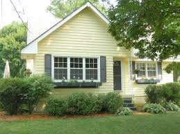 grey shutter pale yellow house landscaping paint colors
