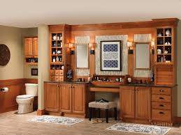 Merillat Kitchen Cabinet Doors by Merillat Masterpiece Tall Entertainment Cabinet With Pocket Doors