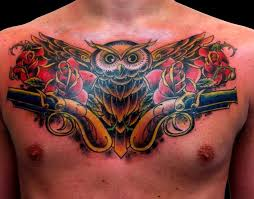 pistol and skull tattoos on whole chest in 2017