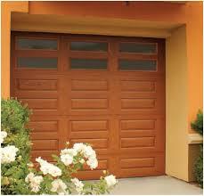 modern house with small fiberglass garage door outdoor