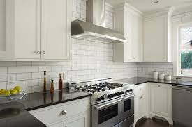 white backsplash kitchen how to choose the right backsplash for your granite kitchen counters