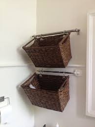 Decorative Bathroom Storage by Cut Down A Curtain Rod And Hang Wicker Baskets For Cute U0026 Easy