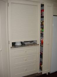 The Rollerdoor Cupboard At The End Of The Bench Is Discreet And - Kitchen cabinet roller doors