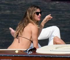 gisele bundchen shows off her posterior as she sunbakes