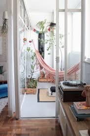 indoor hammock retreat with indoor plants and lots of windows to