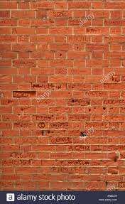 Corbelled Brick Names Of Schoolchildren Scratched Into Red Brick Wall In