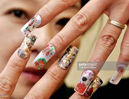 nail salon manager displays its japanese acrylic nail art photos
