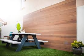 custom wood accent wall and backyard picnic bench in orange county
