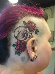 skull with roses on right the ear