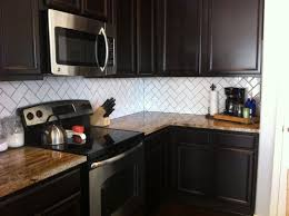 black kitchen cabinets with white subway tile backsplash perhaps laughter brings clarity addicted 2 decorating