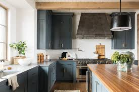 hardware for walnut cabinets blue inset kitchen cabinets with aged brass hardware