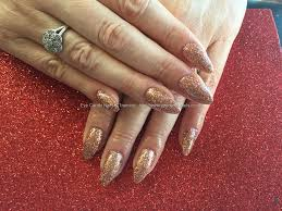 acrylic nails with rose gold glitter dust artificial nails