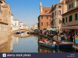 canal in chioggia italy with typical italian houses and gondolas