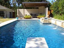 modern swimming pool designs seat on floor glass