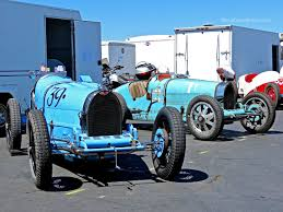 vintage bugatti race car various racing machines in the laguna seca paddock mind over motor
