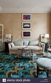 large sofa in drawing room with bright rug designed by allegra