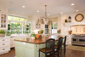 large windows above sink l shape island with chairs kitchen