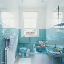 bathroom with turquoise tiles and natural light coming in through