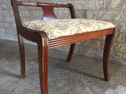 small upholstered bench with short back