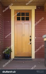 wooden front door upscale home view stock photo 115014250