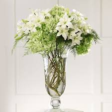 white floral arrangements and hydrangea altar arrangement at send flowers