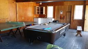 Ping Pong Pool Table Games Room With Busted Ping Pong Table And Garbage On The Pool