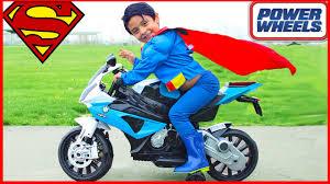 superman vs spiderman power wheels race giant surprise toys kids