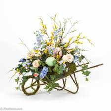 Springtime Flower Arrangements - spring arrangement in moss wheelbarrow would like to see