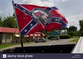 Dixi Flag A Confederate Flag Is Seen Flying Off The Bed Of A Pickup Truck In