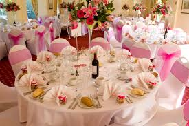 beautiful wedding table setting pink flower centerpieces white