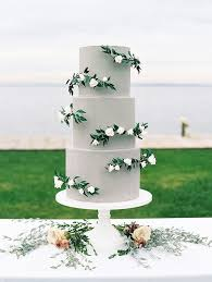 wedding cakes decorated with sugar greenery brides