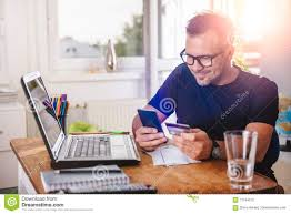 man paying with credit card on smart phone stock photo image