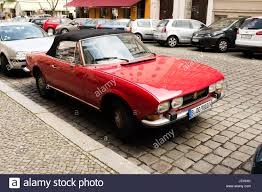 peugeot 504 coupe pininfarina berlin may 3th a vintage red peugeot 504 cabriolet from the 70s