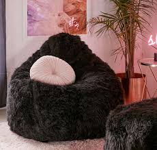 shaggy faux fur bean bag chair and ottoman at urban outfitters