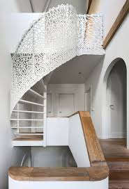 unique wood home stairs circular design with wire railing design