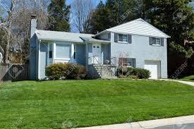 blue brick split level single family house in suburban maryland