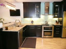 Dark Kitchen Cabinets With Backsplash Neutral Granite Countertops Hgtv With White Kitchen Light