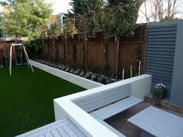wooden and grey garden wall designs with green grass can add the