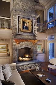 cream stacking stone wall fireplace black frame fireplace brown