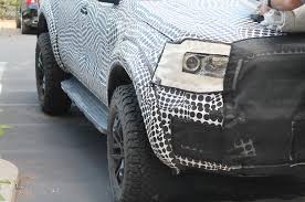 ranger ford 2019 spied 2019 2020 ford ranger raptor with suspension camo photo