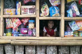 alumni spotlight mariana prieto product design dm little girl at a sari sari store at the market in tacloban philippines photo courtesy of ideo org