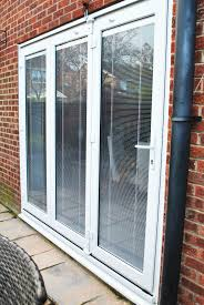 a stunning installation of upvc bifolds with integral blinds