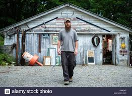 portrait of wood artist in front of workshop stock photo royalty