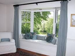 glamorous how to hang curtains in a bay window seat with pillows like the curtain idea
