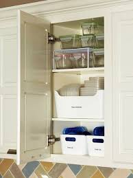 kitchen cabinet storage containers 7 tricks for taming your cabinet of food storage containers