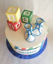 building blocks baby shower cake in primary colors perfect for