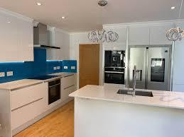 white gloss kitchen cupboards howdens howdens white gloss handleless kitchen island neff appliances worktops 3831133 sale