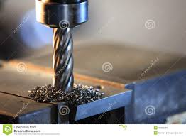 process drilling steel plate by milling machine stock photo